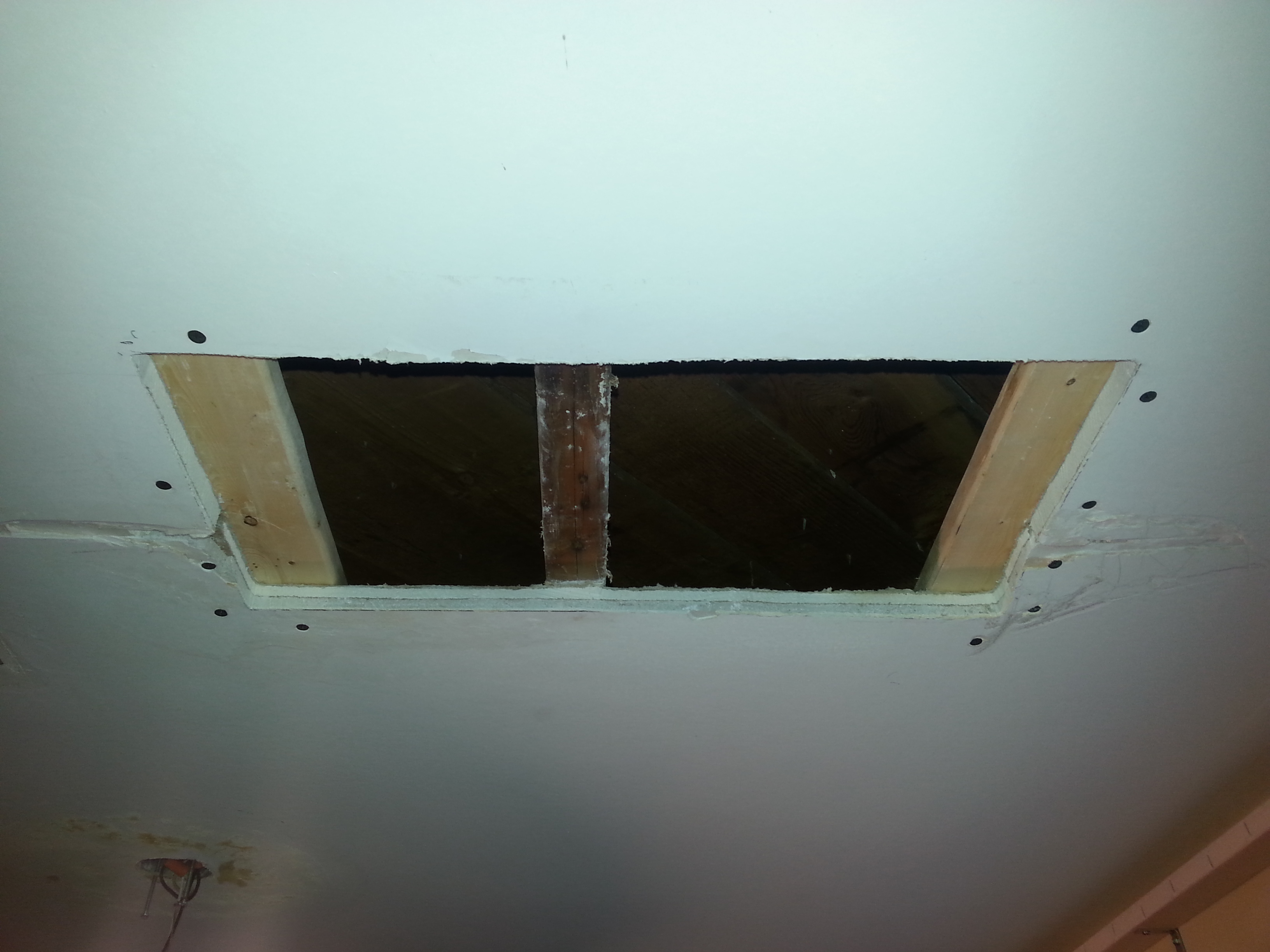 retexturing ceiling foyer hole drywall before repair installation